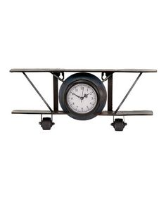 This airplane clock is reminiscent of the early days of aviation. Place it on a bookshelf or desk for a little vintage flair.