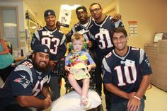 Members of the 2014 Patriots rookie class visited Boston Children's Hospital to surprise children and their families on June 23.