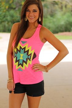 There are many things we love in fashion and this tank has at least 3 from our top 10! Neon, aztec print and sequins!! Bonus round: it's suuuper soft! ;) Fits true to size. Miranda is wearing the small.
