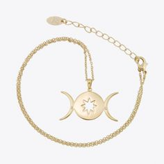 A moon and star inspired necklace made with Swarovski crystal in gold colour plated brass. Pendant measures 30mm across with a 46cm chain with 5cm extension. Made in the United Kingdom.