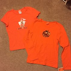 2 girls Halloween shirts size 7/8 Two girls Halloween shirts. The first one is from target and is new with tags it is longsleeve with sequined pumpkin on the front. Size 7/8.  The next is a short sleeve shirt with dog screenprint on front.  it is from target. it is a size 7/8. Misc Shirts & Tops