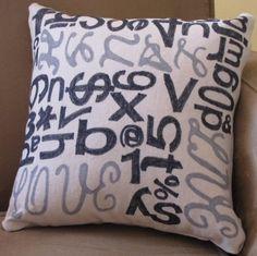 Word pillow cute for a library or chair near a book shelf
