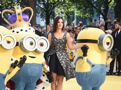 Oscar-winning actress Sandra Bullock poses with Minion figures on the red carpet at the world premiere of 'Minions' at Leicester Square in London, Britain, on June 11, 2015. Bullock voices the film character Scarlet Overkill.   Andy Rain, EPA