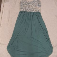 High low strapless dress. Size M. Light green strapless high low dress with lace detailing. In good condition. No trades. Dresses High Low