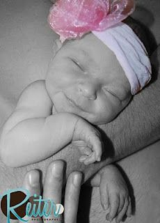 Sweet smile and only hours old