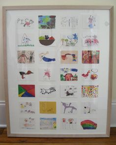 take a bunch of kid art, scan and shrink it, and create a framed collage.