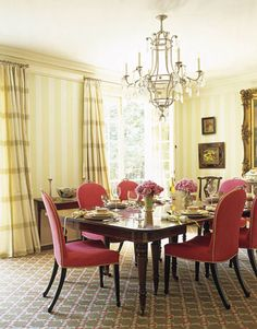 Dining chairs through Travis & Co., Atlanta, are upholstered in Manuel Canovas Indochine in cerise. Curtains are Locust Valley Check in leaf by Lee Jofa; wallcovering, custom-colored Peter Fasano awning stripe. Chandelier is DuPont from Dennis & Leen.