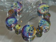 FIRE LOTUS with a twist. lampwork beads set of 9 by Flameartbytd  KRONOS FRIT