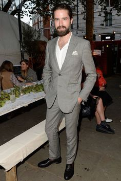 Jack Guinness is making a name for himself as one of the most stylish men in London, frequently appearing on red carpets and contributing to scores of magazines. He's particularly great at the English dandy look, as pictured here. Pictured: At a Club Monaco Sloane Square party  Getty Images  - HarpersBAZAAR.com