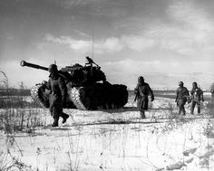 Men of US 1st Marine Division with M26 Pershing tank near Chosin Reservoir Korea December 1950.