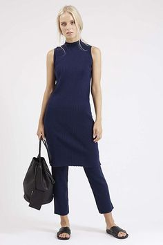 Layering a tunic or dress over a pair of straight, cropped pants, or, wearing a short skater's dress over slim pants with a belt or scarf is hot right now.  If you don't know how you'll look, try on a shift dress over leggings or skinny crops, leave jewelry to a minimum, and add a large tote with flats to start.