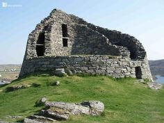 This is Carloway Broch, on the Island of Lewis in Scotland looking something like a broken tooth on the jaw of the island. It's a fortified home built during the Iron Age some 2,100 years ago. Much of the stone from the broch will have been used by locals over the centuries to build their cottages. Brochs, unique to Scotland, are dry-stone, twin-walled, round towers up to 30m across and 15m high. In 2004 a broch was built by the West of Scotland Dry Walling Association www.wsdswa.org.uk