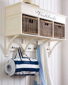 Could use a bench made for a mudroom and attach to the wall at the studs. Don't you love the word 'vestibule' ... ?