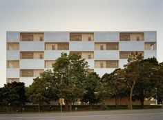 Andreas Martin-Löf Arkitekter has completed a cluster of affordable apartment blocks in the Swedish capital, featuring facades with alternating opaque and transparent sections