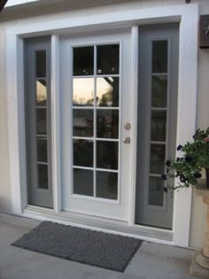 Single French style door with insulated glass and sidelights.