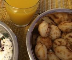 Crisp yet soft Paniyaram, served with coconut chutney and Home Made Mango Frooti, which my mother makes every year for her grand children. This post is dedicated to my North Indian friends and family . For me it was a good addition to my son's tiffin box along with another breakfast option. My entire family loves them . Idlis are best made when the batter is fresh or just a day or two old. In case your batter is older than that, kept in the fridge, you could make these yummy paniyarams. They…