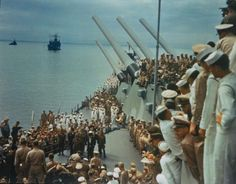 Soldiers and sailors on the decks of the USS Missouri to watch the Japanese surrender which was signed on board. 1945.
