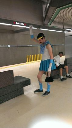 Sailor Freddie Mercury wins at cosplay, life, and accessorizing with a cute handbag.