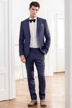 A linen suit is the ultimate summer luxury. Lightweight and breathable with a crumpled look of cool, try navy blue for a look that's dressed-up but not stuffy.   H&M Men's Classics