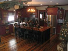beautiful kitchen **Love the black Island!** #PrimitiveKitchen