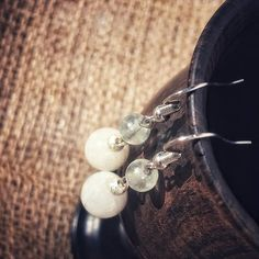 "Powerful moonstone and fluorite beaded earrings. Delicately handcrafted, each features a 10mm moonstone bead and 6mm fluorite bead. Approx 2"" stainless steel ear hooks Moonstone is a stone of new beginnings- traditionally moonstone has been used to help enhance psychic abilities."