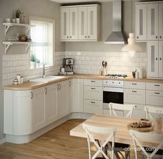 B&Q - IT Stonefield Stone Classic Style. Homely and charming, our Stonefield Classic Ivory Style kitchen gives a rustic feel, modernised with tone-on-tone cabinets and colour palettes, softened with a lightened wood. Click here for more information - http://bit.ly/1KEPecO