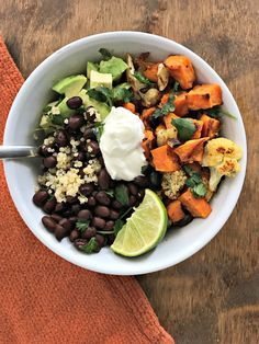 Roasted Sweet Potato & Cauliflower Power Bowl with black beans and quinoa. A bowl full of plant protein, fiber, and plenty of flavor!   recipe via www.yourchoicenutriiton.com