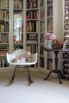 I guess you know you're a nerd when you notice the books over the baby. I want to have this many books on this many shelves.