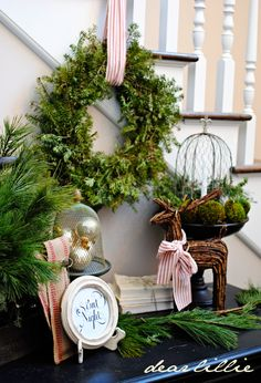 Christmas greenery vignette -- love the ribbon!