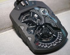 Urwerk UR1001 is an uber complicated timepiece. This pocket watch, also known as a Zeit Device, uses a conucopia of indicators - with satelites on turrets, upon retrograde indication. Limited to 8 individually numbered pieces.