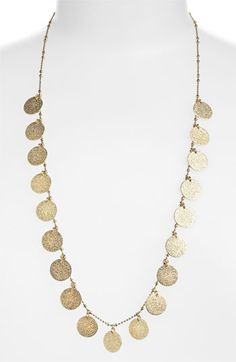 Nordstrom Long Textured Disc Necklace....I love this type of necklace, it looks greek inspired.  I would pair it with a flowy white deepcut top or dress.
