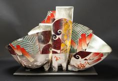 Bennett Bean is a sculptor and painter who works in clay. He is primarily known for his hand formed vessels that are decorated post firing with gold leaf and colorful abstract patterns and shapes. Found on his Facebook page. Sept. 1, 2014: https://www.facebook.com/photo.php?fbid=10152688581619452&set=pcb.10152688581909452&type=1&theater