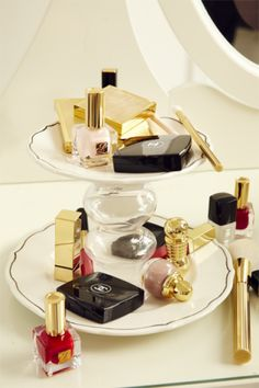 Your makeup deserves a swanky home. With glue, attach a candlestick holder from the dollar store between two plates. (Use a large one as the base and a smaller one on top.)