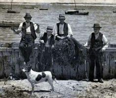 Fishermen repairing their net's on the waters edge, at Botany Bay,Sydney in the early 1900's.  v@e.
