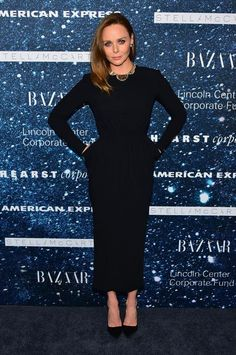Stella McCartney wearing a black long sleeve dress with rouched waist detailing of her own design paired with vintage Cartier jewelry.  Photo courtesy of Getty Images.