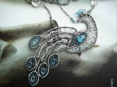 Elisabeth the Virgin Peacock - sterling silver and blue topaz gemstone necklace $426