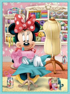 Minnie working hard on making dresses in her craft room