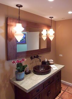 love this set up, but the mirror and the vanity wood do not match...maybe an artistic statement mirror?