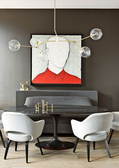 Shamir Shah prefers custom contemporary lighting for his interiors. In this Park Avenue apartment, he hung a chandelier by Lindsey Adelman between a Eero Saarinen table and chairs. Photo by Manolo Yllera