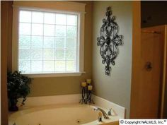 Iron candle and wall décor in bath Master Bathroom Tub, Guest Bathrooms, Bathroom Windows, Bathroom Wall, Dream Bathrooms, Beautiful Bathrooms, Bathroom Ideas, Garden Tub Decorating, Tuscan Decorating