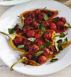 Fresh and vibrant roasted Romano peppers with cherry vine tomatoes and kalamata olives. Serve with a rocket salad for a healthy dish.