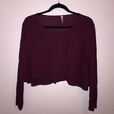 Red long sleeve crop top! Dark red long sleeved crop top! Comfortable and cute! Only been worn a couple of times before! Urban Outfitters Tops Crop Tops