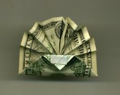 Impress your dinner guests by folding a Dollar Bill Turkey Origami for Thanksgiving.        Difficulty: Easy    Directions:   1. Begin by ...
