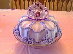 Sofia the First cake Use a decorative bunds pan for shape. I added a cupcake in the middle hole.