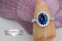 Kennington Jewelers Custom: Don't you want to just dive right in to the lustrous depths of this sapphire? This ring will make a splash at any occasion! Have a masterpiece in mind? When you need us, we'll be here for you.  www.kenningtonjewelers.com  #KenningtonJewelers #custom #sapphire #diamonds #customdesignjewelry #customring #makeasplash