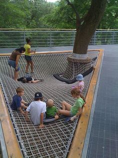 This hammock structure encourages use by families, as evidenced in the photo. A public structure that encourages play as well as connects the user to nature greatly improves the average citizen's quality of life in the city.