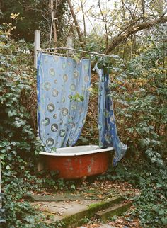 Outdoor Bath. Switch the shower curtain to a white mosquito net with white stepping stones and this would be even more gorgeous!