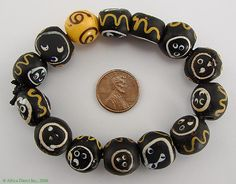 Trade Beads   12 Round Baule Face Venetian Beads Trade Beads, and one Yellow Venetian Zen Bead (RARE)   Type of bead: wound and decorated     Made in: Venice, found in Africa   Age: late 1800s, early 1900s   $ 890.00 for the strand