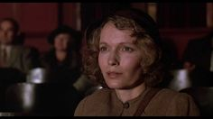 "The Purple Rose of Cairo (1985) - ending.  I did like this quirky movie.  There is s a sense of melancholy to the ending, however.  Mia Farrow's character is betrayed - in a way, she's lost it all, but yet, everything is forgotten once she starts watching the movies, again.  She's moved on - from one movie hero to another.  Movies (and Disneyworld, for that matter) are pure escapism. On another note, the ""Cheek to Cheek"" Astaire and Rogers scene is lovely, and the music is lovey, as well."