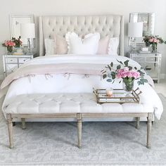(@thedecordiet) on Instagram, bedroom inspiration, bedroom decor, tufted linen bed, white bedding, white duvet, pink duvet cover, glam bedroom, mirrored nightstands, tufted bench, grey rug, classic gray paint by Benjamin Moore